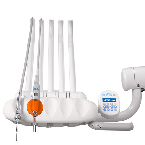 Performer dental delivery system with curing light