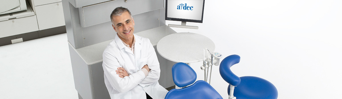 Dentist with A-dec dental equipment