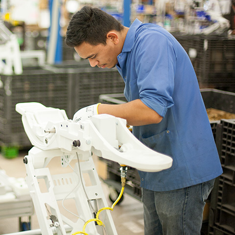 A-dec employee at work manufacturing dental equipment