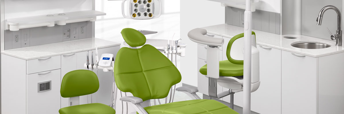 A-dec dental chair with parrot upholstery in dental operatory